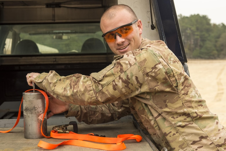 Staff Sgt. Graham Speight, 4th Civil Engineer Squadron explosive ordnance disposal technician, handles the explosives needed to safely detonate a hung flare from an F-15E Strike Eagle aircraft, Nov. 9, 2016, at Seymour Johnson Air Force Base, North Carolina. EOD Airmen provide emergency response capabilities to the flightline and the entire base when it comes to explosive hazards. (U.S. Air Force photo by Airman Shawna L. Keyes)
