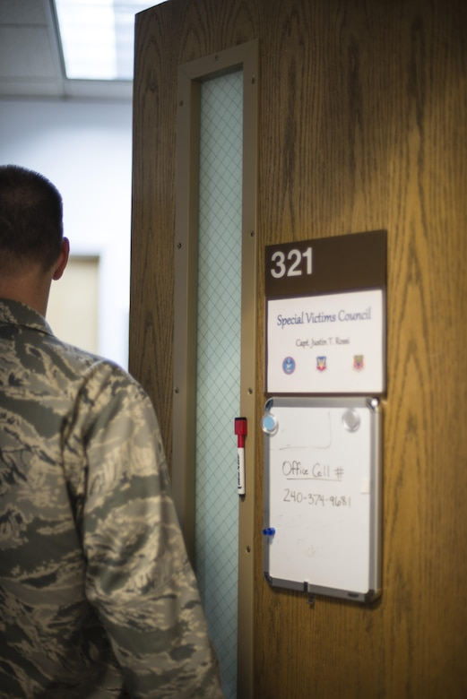 Capt. Justin Rossi, a Special Victims Counsel attorney stationed at Mountain Home Air Force Base, Idaho, enters his office at the 366th Fighter Wing Headquarters Nov. 9, 2016. The SVC provides representation and legal assistance for victims of sexual assault. (U.S. Air Force photo by 2nd Lt. Kevyn Stinett/Released)