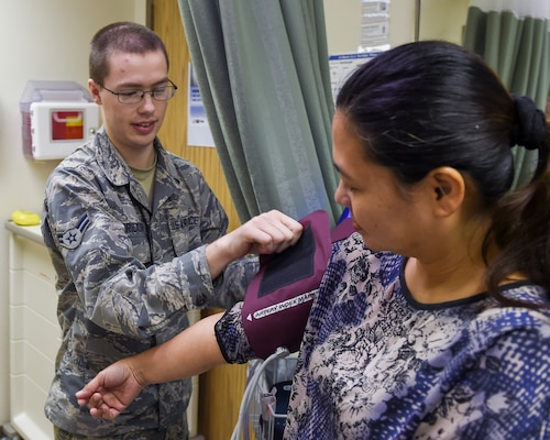 Airman 1st Class JaCoy Erickson, a medical technician with the 59th Medical Wing, checks a patients vitals at the Wilford Hall Ambulatory Surgical Center Family Health Clinic on Joint Base San Antonio-Lackland, Texas, Nov. 10, 2016. Erickson and two of his colleagues recently developed a standardization protocol that will increase patient safety and is estimated to save the wing $61,000 annually. (U.S. Air Force photo/Staff Sgt. Michael Ellis)