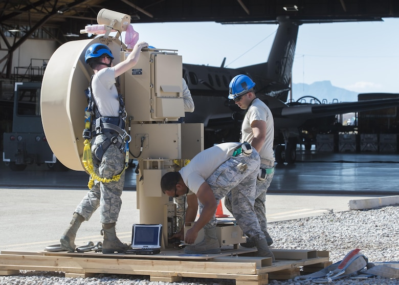 Aircraft communications maintenance Airmen from the 49th Aircraft Maintenance Squadron prepare a Ground Data Terminal antenna to be crane lifted at Holloman Air Force Base, N.M., on Nov. 8, 2016. The GDT is an 800-pound antenna that facilitates communication between Remotely Piloted Aircraft and their crews on the ground in the Ground Control Station. (U.S. Air Force photo by Senior Airman Emily Kenney)