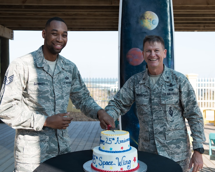 Brig. Gen. Wayne Monteith, 45th Space Wing commander, and Staff Sgt. Dominique Barrett, 45th Force Support Squadron Career Development supervisor, cut a cake during the 45th Space Wing's 25th Anniversary Celebration Nov. 10, 2016, at the Beach House at Patrick Air Force Base, Fla.  The 45th Space Wing will celebrate another significant milestone in its rich and storied history of providing assured access to space when the wing turns 25 years young on Nov. 12, 2016. (U.S. Air Force photo by Matthew Jurgens)
