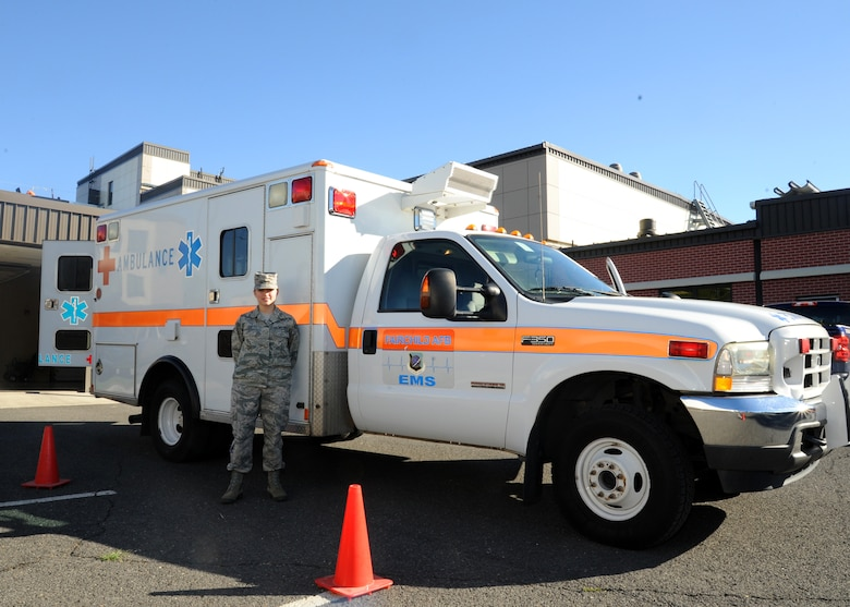 Senior Airman Ashley Cox, 92nd Medical Operations Squadron emergency medical technician, stands beside one of the two base clinic ambulances, Aug. 18, 2016, at Fairchild Air Force Base, Wash. EMTs assist clinic staff during the day and operate alongside firefighters at night. (U.S. Air Force photo/Senior Airman Samuel Fogleman)