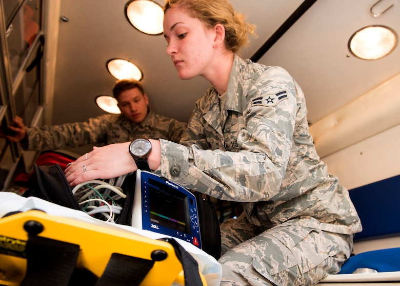Senior Airman Corey Justice Louis, 92nd Medical Operations Squadron emergency medical technician, trains Airman 1st Class Shawn Regina McMahan, MDOS EMT trainee, on the operation of ambulance lifesaving equipment, Aug. 18, 2016, at Fairchild Air Force Base, Wash. EMTs receive constant updates to the basic lifesaving skills training they use every day. (U.S. Air Force photo/Airman 1st Class Ryan Lackey)