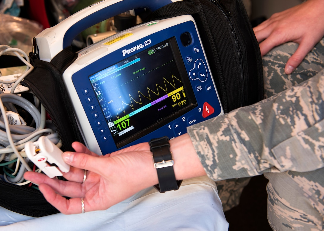Airman 1st Class Shawn Regina McMahan, 92nd Medical Operations Squadron emergency medical technician, runs a diagnostic test of a mobile vitals monitor, Aug. 18, 2016, at Fairchild Air Force Base, Wash. Fairchild EMTs work with local civilian paramedic units to move stable patients to a local hospital. (U.S. Air Force photo/Airman 1st Class Ryan Lackey)