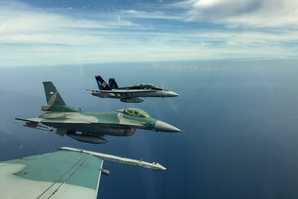 A U.S. Marine Corps F/A-18D Hornet with Marine All-Weather Fighter Attack Squadron (VMFA (AW)) 225 and two Indonesian Air Force F-16 Fighting Falcons fly in formation during exercise Cope West 17 in Indonesia, Nov. 4, 2016. This fighter-focused, bilateral exercise between the U.S. Marine Corps and Indonesian Air Force is designed to enhance the readiness of combined interoperability between the two nations. Both the U.S. F/A-18D Hornets and Indonesian F-16 Fighting Falcons bring unique capabilities affording the associated countries the opportunity to learn and understand each other's skills, preparing them for real world contingencies and further strengthening their relationship. (Courtesy photo by TNI-AU Capt. I Gede Ngurah Satrya Wibawa)