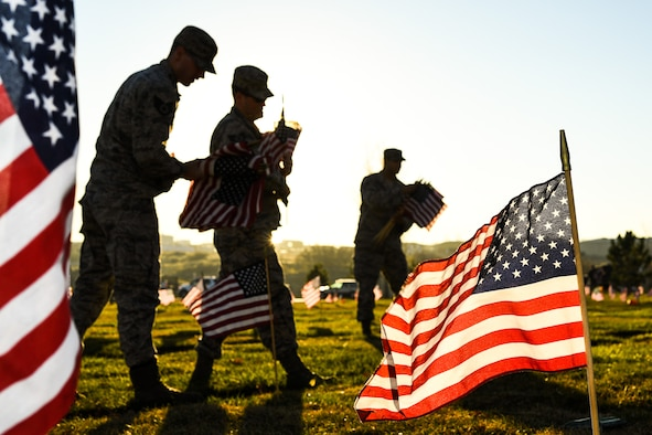Team Hill Airmen carry flag bundles during a flag-placing detail at the Utah Veterans Memorial Cemetery in Bluffdale, Nov. 10. (U.S. Air Force photo by R. Nial Bradshaw))
