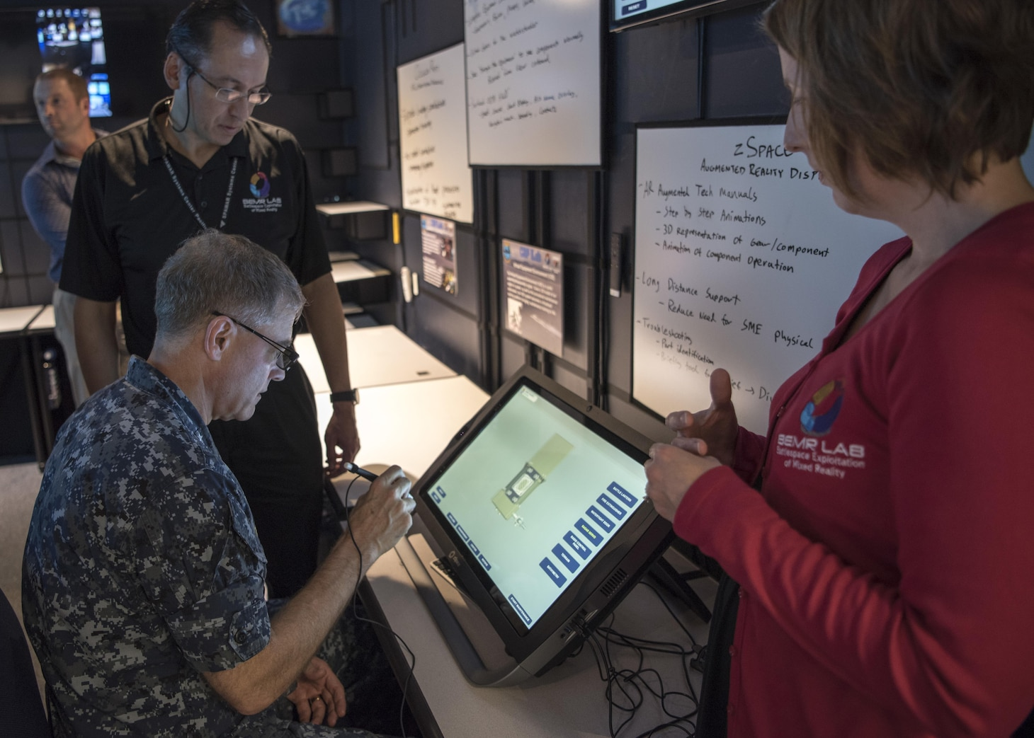 161104-N-LY160-043 PEARL HARBOR, Hawaii (Nov. 7, 2016) Rear Adm. Fritz Roegge, commander, Submarine Force U.S. Pacific Fleet (COMSUBPAC), participates in an augmented-reality demonstration at the official opening of the COMSUBPAC Innovation Lab (iLab) at Naval Submarine Training Center Pacifc in Joint Base Pearl Harbor-Hickam, Nov. 7. The iLab's mission is to provide Sailors with cutting-edge battlespace visualization capabilities using virtual and augmented reality. (U.S. Navy photo by Petty Officer 2nd Class Michael H. Lee/Released)