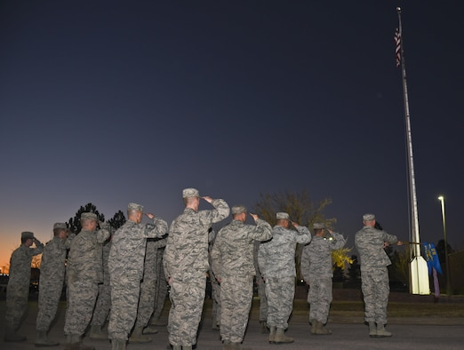 Members from the 28th Munitions Squadron render a salute during a retreat ceremony at Ellsworth Air Force Base, S.D., on Nov. 10, 2016. The ceremony was performed in commemoration of Veterans Day, which has been a National Holiday every eleventh day of the eleventh month since President Dwight. D. Eisenhower issued the first Veterans Day Proclamation in 1938. (U.S. Air Force photo by Airman 1st Class Randahl J. Jenson)