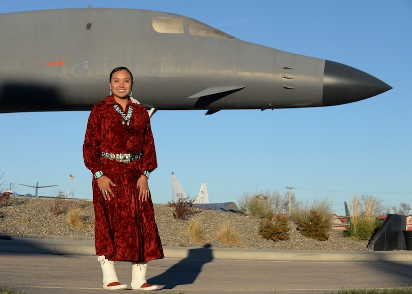 Staff Sgt. Anika Dexter, an individual protective equipment supervisor assigned to the 28th Logistics Readiness Squadron, poses in her traditional Navajo clothing for a photo in front of a B-1B Lancer at the South Dakota Air & Space Museum Nov. 10, 2016 at Ellsworth Air Force Base, S.D. Dexter, a Navajo Native American from the Southwest proudly displays her turquoise jewelry. (U.S. Air Force photo by Senior Airman Anania Tekurio)