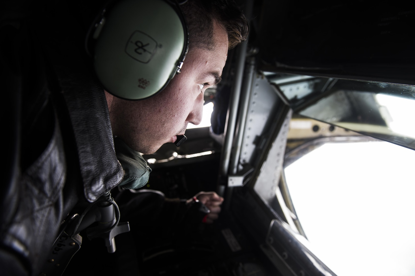 Staff Sgt. Nick Eykamp, boom operator, 92nd Aerial Refueling Squadron, Fairchild Air Force Base, Wa., waits to begin refueling aircraft in a the boom pod of a KC-135 stratotanker after takeoff in support of Vigilant Shield 2017 Field Training Exercise 17 Oct., 2016,at Joint Base Elmendorf-Richardson, Alaska.