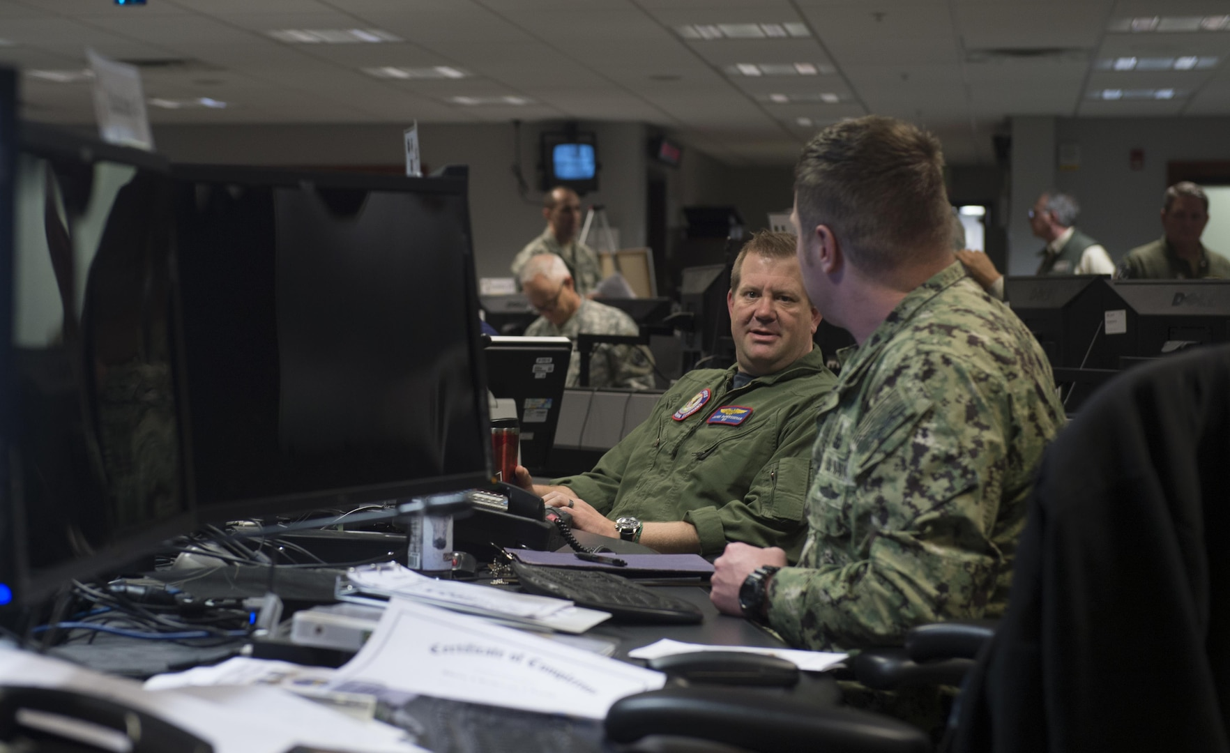 U.S. and Canadian armed forces Service members participating in The Vigilant Shield 2017 Field Training Exercise work in the joint operations center at headquarters Alaskan Command at Joint Base Elmendorf-Richardson, Alaska, 16 Oct., 2016.