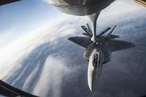 U.S. Air Force F-22 Raptors from Joint Base Elmendorf-Richardson, Alaska, receive fuel from a KC-135 Stratotanker flown by the 92nd Aerial Refueling Squadron from Fairchild Air Force Base, Wa., while both units participate in the Vigilant Shield 2017 Field Training Exercise 17 Oct., 2016, in the high arctic. 
