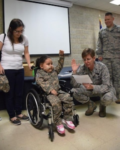 Col. Gretchen Wiltse, right, 433rd Maintenance Group commander, administers a military oath to 5-year-old Mayra Salinas, while the child's mother, Ashley Salinas, observes,  Nov. 5, 2016 at Joint Base San Antonio-Lackland, Texas. Salinas became an honorary member of the Rising 6, a private organization at the 433rd Airlift Wing comprised of Airmen in the grade of E-1 to E-6. (U.S. Air Force photo/Tech. Sgt. Carlos J. Treviño)