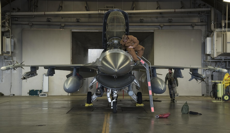 U.S. Air Force Airman 1st Class Patrick O'Connell, left, a 35th Maintenance Squadron crew chief and Capt. Kyle Benham, right, a 35th Fighter Wing F-16 Fighting Falcon pilot, performs a pre-flight check during exercise Keen Sword 17 at Misawa Air Base, Japan, Nov. 10, 2016. Misawa participated in a series of bilateral exercises, showcasing the positive relationship with our Japanese host nation. (U.S. Air Force photo by Airman 1st Class Sadie Colbert)