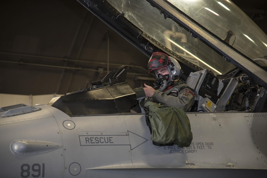 U.S. Air Force Capt. Kyle Benham, a 35th Fighter Wing F-16 Fighting Falcon pilot, dons his piloting gloves before flight during bilateral exercise Keen Sword 17, at Misawa Air Base, Japan, Nov. 10, 2016. The exercise had various scenarios, including defending the Hokkaido Port, in Hokkaido, Japan, from a multitude of enemies. The U.S. has maintained a diplomatic, economic, and military presence in the Pacific throughout our nation's history. (U.S. Air Force photo by Airman 1st Class Sadie Colbert)