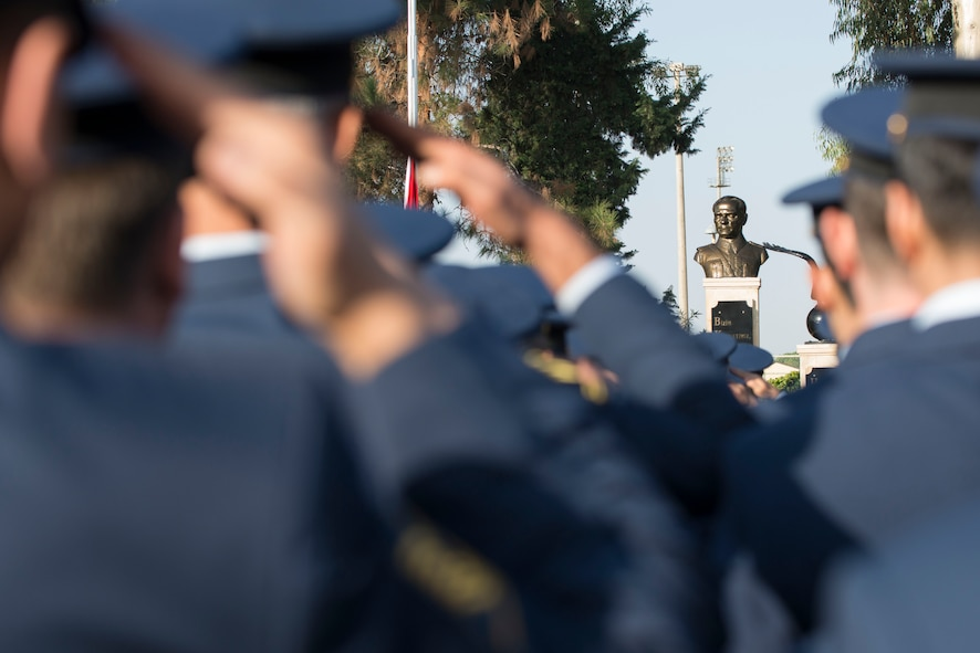 Turkish Air Force members assigned to the 10th Tanker Base salute a statue of Mustafa Kemal Ataturk during a memorial ceremony Nov. 10, 2016, at Incirlik Air Base, Turkey. More than 300 service members gathered for the ceremony to pay homage to Ataturk. (U.S. Air Force photo by Senior Airman John Nieves Camacho)
