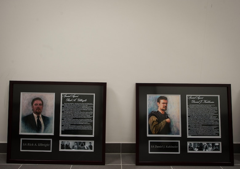 Two portraits of fallen Air Force Office of Special Investigations Airmen lay on the floor during the 25th Expeditionary Field Investigation Squadron's fallen heroes dedication ceremony at Ramstein Air Base, Germany, Nov. 10, 2016. The 25th EFIS held the ceremony to commemorate AFOSI agents who lost their lives in the line of duty. Veteran's Day is a celebration to honor America's veterans for their patriotism, love of country, and willingness to serve and sacrifice, even if it means their lives. According to a recent Congressional Research Service report, more than 6,500 U.S. service members have lost their lives in post-9/11 conflicts in Iraq and Afghanistan. (U.S. Air Force photo by Airman 1st Class Lane T. Plummer)