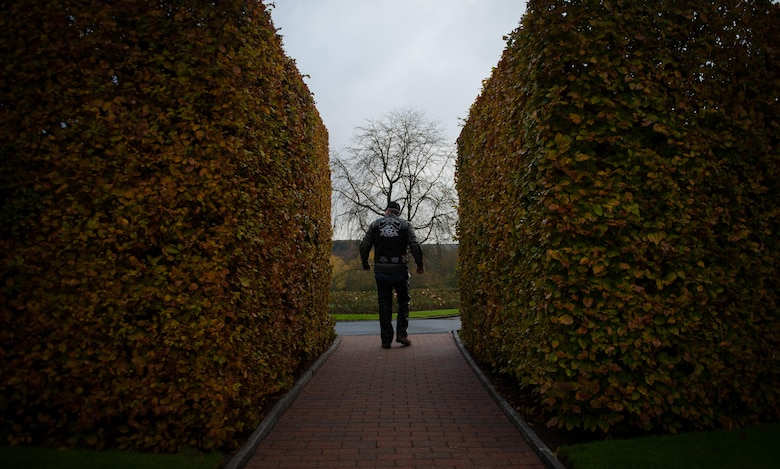 A member of the Ramstein military motorcycle club from the Kaiserslautern Military Community walks through the entrance of the Lorraine American Cemetery Nov. 11, 2016, at St. Avold, France. Veterans Day is observed annually on November 11 and commemorates military veterans who currently serve or have served the U.S. armed forces, including those who gave the ultimate sacrifice. According to the DoD and Veterans Administration, since World War I, approximately 624,000 U.S. servicemembers have been killed in action battling in wars and conflicts. The Lorraine American Cemetery contains the buried remains of over 10,000 of them. It is the largest burial site of U.S. servicemembers in Europe. (U.S. Air Force photo by Airman 1st Class Lane T. Plummer)