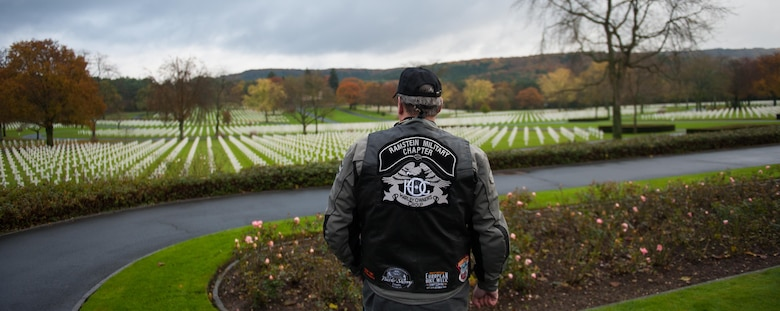 A member of the Ramstein military motorcycle club gazes upon the rows of graves of deceased war veterans at the Lorraine American Cemetery Nov. 11, 2016, at St. Avold, France. Veteran's Day is observed annually on November 11 and commemorates military veterans who currently serve or have served the U.S. armed forces, including those who gave the ultimate sacrifice. According to the DoD and Veterans Administration, since World War I, approximately 624,000 U.S. servicemembers have been killed in action battling in wars and conflicts. The Lorraine American Cemetery contains the buried remains of over 10,000 of them. It is the largest burial site of U.S. servicemembers in Europe. (U.S. Air Force photo by Airman 1st Class Lane T. Plummer)