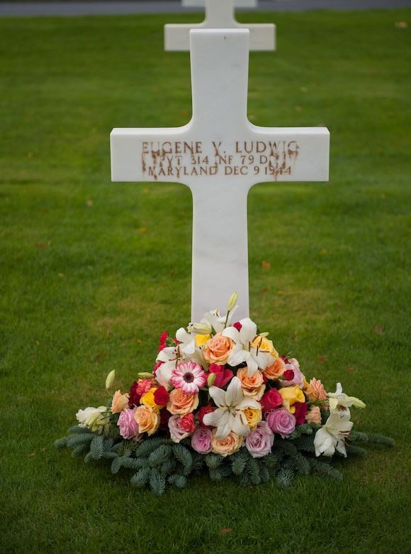 Flowers lay next to a deceased war veteran's gravestone at the Lorraine American Cemetery Nov. 11, 2016, at St. Avold, France. Veterans Day is observed annually on November 11 and commemorates military veterans who currently serve or have served the U.S. armed forces, including those who gave the ultimate sacrifice. According to the DoD and Veterans Administration, since World War I, approximately 624,000 U.S. servicemembers have been killed in action battling in wars and conflicts. The Lorraine American Cemetery contains the buried remains of over 10,000 of them. It is the largest burial site of U.S. servicemembers in Europe. (U.S. Air Force photo by Airman 1st Class Lane T. Plummer)