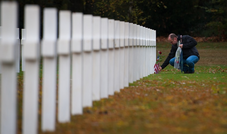 Eric Schell, a French citizen, lays a U.S. flag and flowers on the gravestone of a deceased war veteran at the Lorraine American Cemetery Nov. 11, 2016, at St. Avold, France. Veterans Day is observed annually on November 11 and commemorates military veterans who currently serve or have served the U.S. armed forces, including those who gave the ultimate sacrifice. According to the DoD and Veterans Administration, since World War I, approximately 624,000 U.S. servicemembers have been killed in action battling in wars and conflicts. The Lorraine American Cemetery contains the buried remains of over 10,000 of them. It is the largest burial site of U.S. servicemembers in Europe. (U.S. Air Force photo by Airman 1st Class Lane T. Plummer)