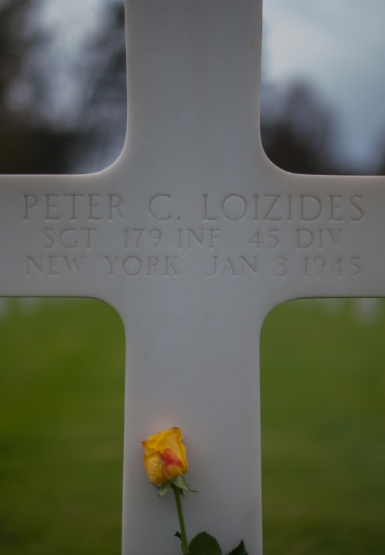 A flower lays on the gravestone of a deceased war veteran at the Lorraine American Cemetery Nov. 11, 2016, at St. Avold, France. Veterans Day is observed annually on November 11 and commemorates military veterans who currently serve or have served the U.S. armed forces, including those who gave the ultimate sacrifice. According to the DoD and Veterans Administration, since World War I, approximately 624,000 U.S. servicemembers have been killed in action battling in wars and conflicts. The Lorraine American Cemetery contains the buried remains of over 10,000 of them. It is the largest burial site of U.S. servicemembers in Europe. (U.S. Air Force photo by Airman 1st Class Lane T. Plummer)