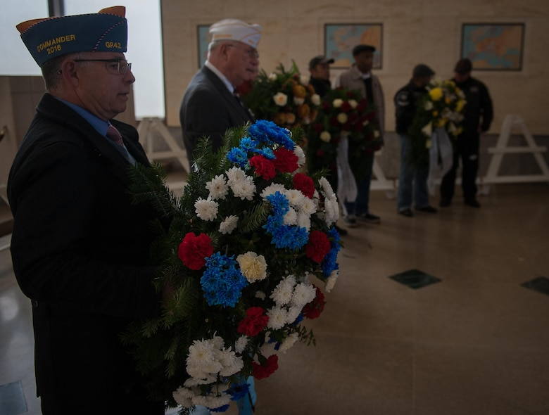 Representatives from several organizations visiting the Lorraine American Cemetery begin a wreath laying ceremony to honor the fallen war veterans Nov. 11, 2016, at St. Avold, France. Veteran's Day is observed annually on November 11 and commemorates military veterans who currently serve or have served the U.S. armed forces, including those who gave the ultimate sacrifice. According to the DoD and Veterans Administration, since World War I, approximately 624,000 U.S. servicemembers have been killed in action battling in wars and conflicts. The Lorraine American Cemetery contains the buried remains of over 10,000 of them. It is the largest burial site of U.S. servicemembers in Europe. (U.S. Air Force photo by Airman 1st Class Lane T. Plummer)