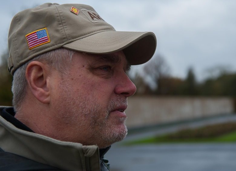 Sean, a U.S. Army veteran, becomes emotional, recalling memories of his friends who died in combat, at Lorraine American Cemetery Nov. 11, 2016, at St. Avold, France. Veteran's Day is observed annually on November 11 and commemorates military veterans who currently serve or have served the U.S. armed forces, including those who gave the ultimate sacrifice. According to the DoD and Veterans Administration, since World War I, approximately 624,000 U.S. servicemembers have been killed in action battling in wars and conflicts. The Lorraine American Cemetery contains the buried remains of over 10,000 of them. It is the largest burial site of U.S. servicemembers in Europe. (U.S. Air Force photo by Airman 1st Class Lane T. Plummer)