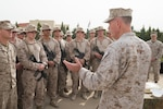 Marine Corps Gen. Joe Dunford, chairman of the Joint Chiefs of Staff, talks with deployed Marines about the importance of the mission in Irbil, Iraq, Nov. 10, 2016. DoD photo by D. Myles Cullen