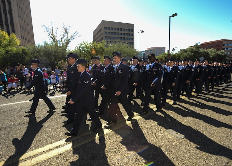 U.S. Airmen from Davis-Monthan Air Force Base march in a formation during the Tucson Veterans Day Parade in Tucson, Ariz., Nov. 11, 2016. More than 100 Airmen participated in the parade, marching approximately two miles in one hour's time. (U.S. Air Force photo by Airman Nathan H. Barbour)
