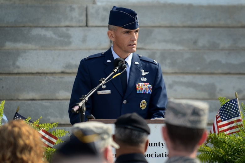 U.S. Air Force Col. Daniel Lasica, 20th Fighter Wing commander, addresses attendees during a Veterans Day ceremony, Sumter, S.C., Nov. 11, 2016. Lasica was the guest speaker for the ceremony held on the front lawn of the Sumter County Courthouse. (U.S. Air Force photo by Airman 1st Class Kelsey Tucker)