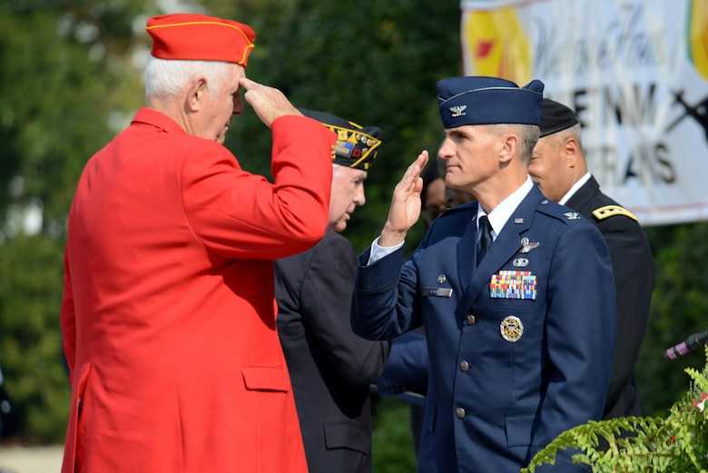 U.S. Air Force Col. Daniel Lasica, 20th Fighter Wing commander, salutes a veteran from the local community during a Veterans Day ceremony, Sumter, S.C., Nov. 11, 2016. During the ceremony, local veterans were recognized and honored for their service to the United States. (U.S. Air Force photo by Airman 1st Class Kelsey Tucker)