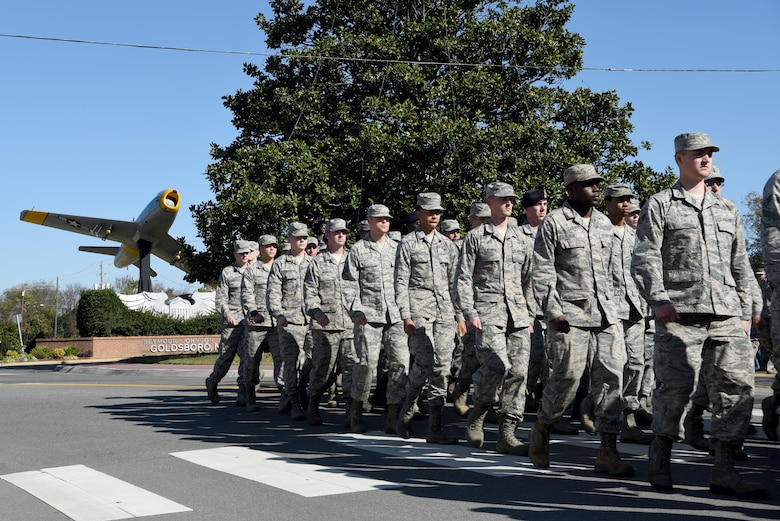 Team Seymour Airmen march in formation during the Wayne County Veterans Day parade, Nov. 11, 2016, in Goldsboro, North Carolina. An estimated 8,000 people attended the annual parade which featured a formation of more than 220 Airmen marching through the streets. (U.S. Air Force photo by Airman 1st Class Kenneth Boyton)
