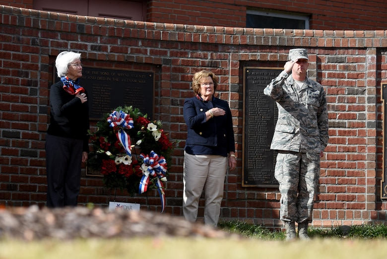 Col. Christopher Sage, 4th Fighter Wing commander, renders a salute during a wreath laying ceremony, Nov. 11, 2016, in Goldsboro, North Carolina. Sage showed his respect to the sacrifice of America's veterans by placing a wreath at the Wayne County Veterans Memorial. (U.S. Air Force photo by Airman 1st Class Kenneth Boyton)
