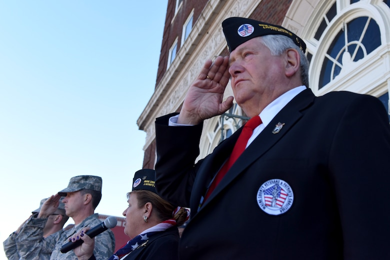 Members of Team Seymour salute during the annual Veterans Day Parade, Nov. 11, 2016, in Goldsboro, North Carolina. Veterans Day marks an opportunity to honor all men and women who serve in uniform. (U.S. Air Force photo by Airman Miranda A. Loera)