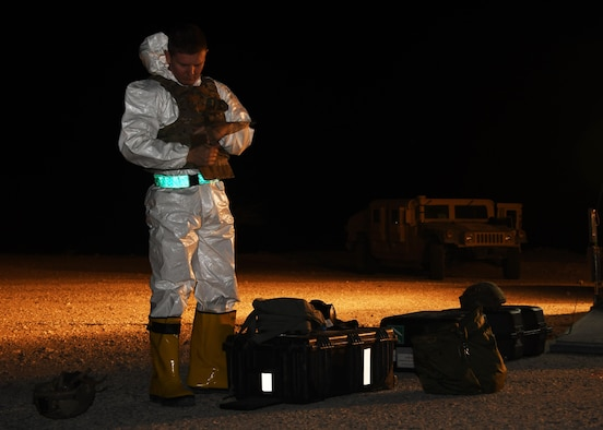 U.S. Air Force Tec. Sgt. Zachary Holschuh, 379th Expeditionary Civil Engineer Squadron explosive ordinance disposal operations section chief, dons his personal protective equipment at Al Udeid Air Base, Qatar, Nov. 9, 2016. Holschuh is a member of the EOD team that participated in an exercise involving a stolen vehicle with possible radiological material. (U.S. Air Force photo by Senior Airman Miles Wilson)