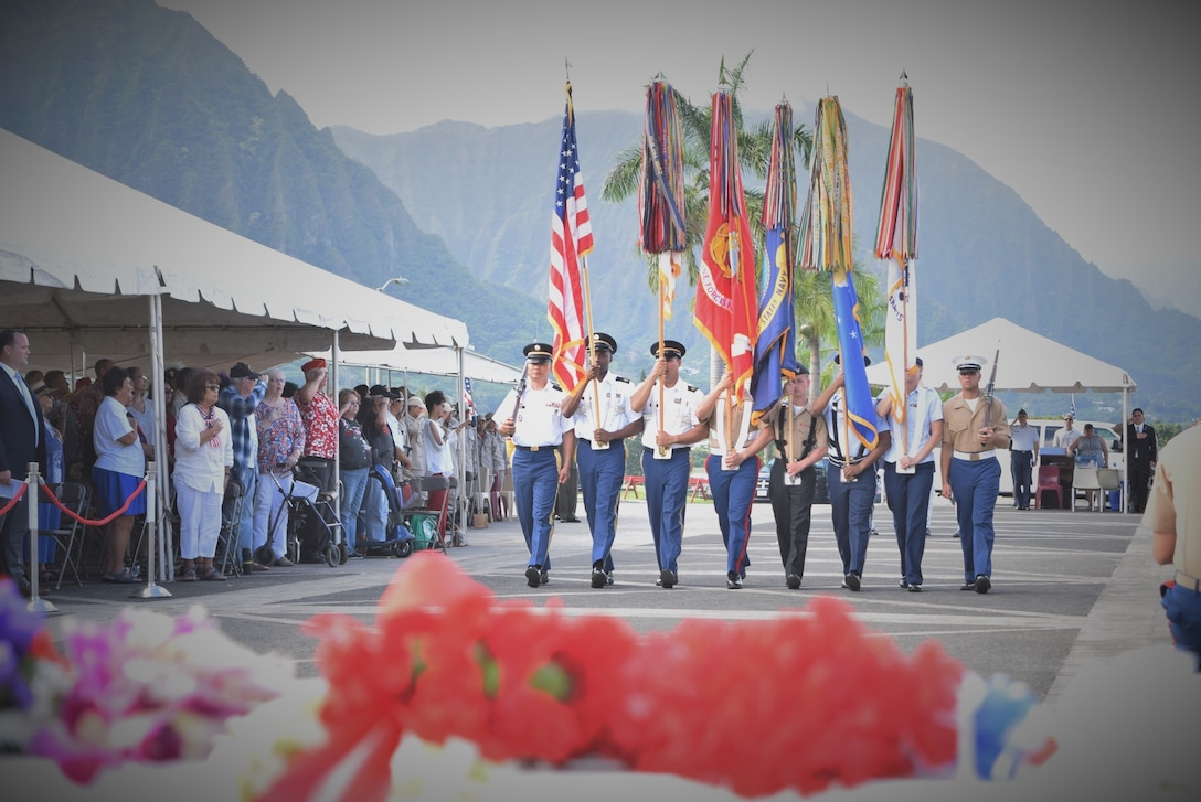 A color guard from U.S. Armed Forces in the Pacific retire the colors at a Veteran's Day ceremony at the Hawaii State Veterans Cemetery, Kaneohe, Hawaii, Nov. 11, 2016. Air Force photo by Master Sgt. Todd Kabalan