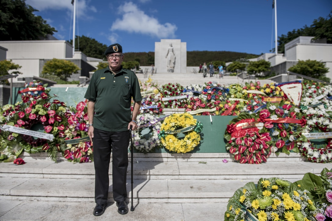 Vietnam veteran retired Air Force Col. Gary Chamberlin stands in front of the Green Beret wreath during a Veterans Day ceremony at the National Memorial Cemetery of the Pacific in Honolulu, Nov. 11, 2016. Chamberlin, who retired from the Air Force, served as an Army Green Beret in the Vietnam War. Navy photo by Petty Officer 2nd Class Aiyana S. Paschal