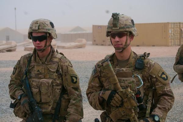 Sgt. Logon Ross, left, and Sgt. Addison Owen, right, Company B, 1st Battalion, 26th Infantry Regiment, Task Force Strike, 101st Airborne Division (Air Assault) in the U.S compound at the Qayyarah West Airfield, Iraq, Nov. 1, 2016. Company B provides security for Coalition forces on the base and was one on the first units at the location. Owen is an infantryman at the base and is on his second deployment to Iraq. On his first deployment in the city of Basra during 2010-2011, Owen was wounded when an explosively formed penetrator hit his vehicle.  (U.S. Army photo by 1st Lt. Daniel Johnson)