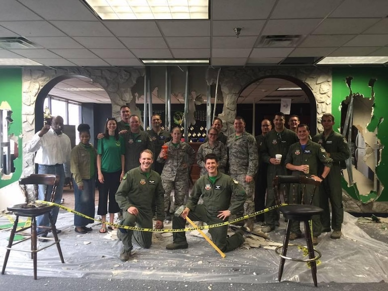 Members of the 12th Airborne Command and Control Squadron pose for a photo during a heritage room revitalization project in JSTARS operational squadron building. (U.S. Air Force photo)