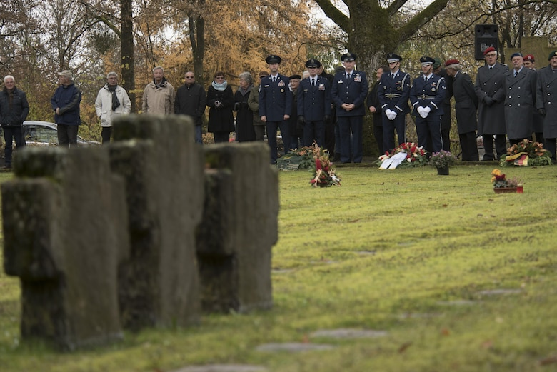 Leaders from the 52nd Fighter Wing, Spangdahlem Air Base, Germany, and German citizens pause during a German National Day of Mourning observance ceremony at the Kolmeshöhe Military Cemetery in Bitburg, Germany, Nov. 13, 2016. The day, known as Volkstrauertag in German, observes the human cost of war and was established following the conclusion of the First World War. (U.S. Air Force photo by Staff Sgt. Joe W. McFadden)