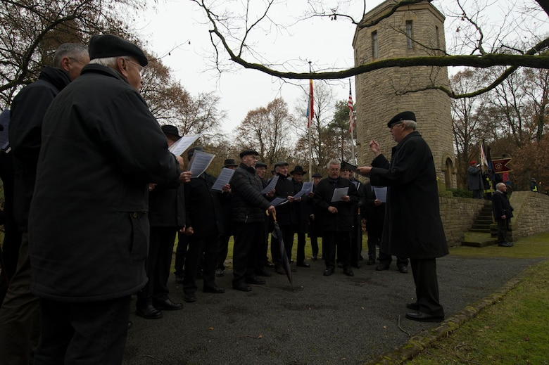 A men's choir group sings during a German National Day of Mourning observance ceremony at the Kolmeshöhe Military Cemetery in Bitburg, Germany, Nov. 13, 2016. The day, known as Volkstrauertag in German, observes the human cost of war and was established following the conclusion of the First World War. (U.S. Air Force photo by Staff Sgt. Joe W. McFadden)