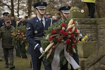 Ceremonial guardsmen from the 52nd Fighter Wing, Spangdahlem Air Base, Germany, present a wreath during a German National Day of Mourning observance ceremony at the Kolmeshöhe Military Cemetery in Bitburg, Germany, Nov. 13, 2016. The day, known as Volkstrauertag in German, observes the human cost of war and was established following the conclusion of the First World War. (U.S. Air Force photo by Staff Sgt. Joe W. McFadden)