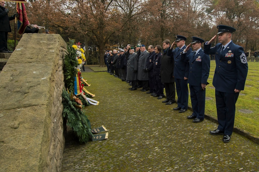 Leaders from the 52nd Fighter Wing, Spangdahlem Air Base, Germany, and German citizens pause after presenting wreaths during a German National Day of Mourning observance ceremony at the Kolmeshöhe Military Cemetery in Bitburg, Germany, Nov. 13, 2016. The day, known as Volkstrauertag in German, observes the human cost of war and was established following the conclusion of the First World War. (U.S. Air Force photo by Staff Sgt. Joe W. McFadden)