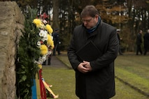 Joachim Kandels, mayor of the city of Bitburg, Germany, reviews a wreath after a German National Day of Mourning observance ceremony at the Kolmeshöhe Military Cemetery in Bitburg, Germany, Nov. 13, 2016.The day, known as Volkstrauertag in German, observes the human cost of warfare and suffering. (U.S. Air Force photo by Staff Sgt. Joe W. McFadden)