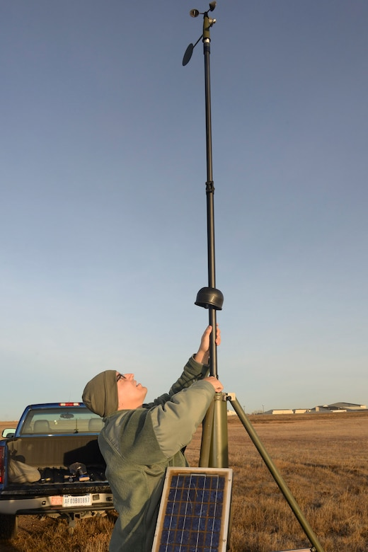 Tech. Sgt. James Pomar, 5th Operations Support Squadron missions NCO in charge, sets up tactical meteorological equipment on the airfield on Minot Air Force Base, N.D., Nov. 8, 2016. The equipment is a transportable system used as a back-up data collection source to ensure weather conditions are suitable for flight and ground operations. (U.S. Air Force photo/Airman 1st Class Jessica Weissman)