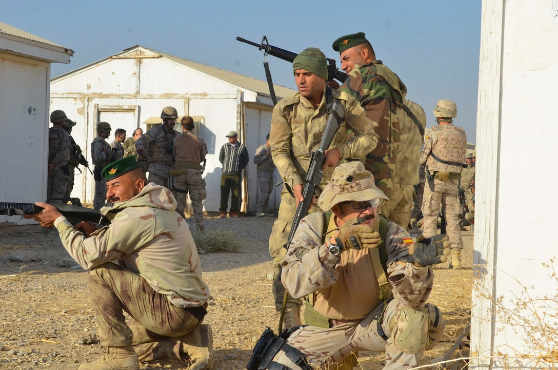 A Coalition trainer from Spain teaches members of the Iraqi Security Forces (ISF) how to pull security during training at the Besmaya Building Partner Capacity site November, 2016.  Training at the building partner capacity sites is an integral part of Combined Joint Task Force – Operation Inherent Resolve's multinational effort to train ISF personnel to defeat the Islamic State of Iraq and the Levant.  The mission of Operation Inherent Resolve is to defeat Da'esh (an Arabic acronym for ISIL) in Iraq and Syria by supporting the Government of Iraq with trainers, advisors and fire support, to include aerial strikes and artillery fire.  (U.S. Army photo by Spc. Ethan Hutchinson/Released)