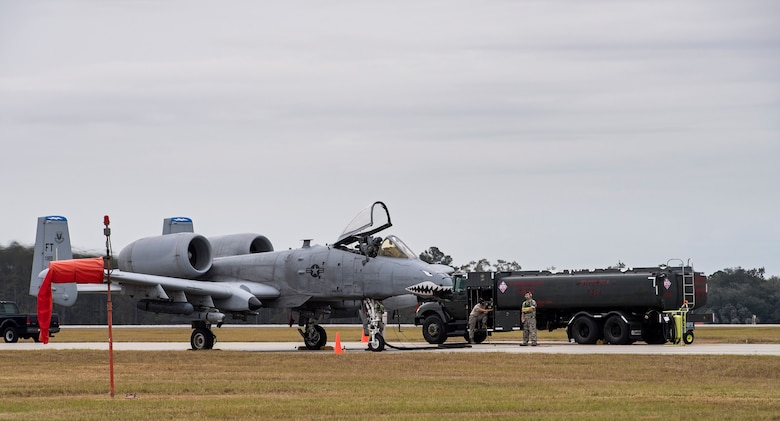 Airmen from the 23d Logistics Readiness Squadron petroleum, oil and lubricants flight perform a hot pit refuel on an A-10C Thunderbolt II, Nov. 9, 2016, at Moody Air Force Base, Ga. This type of refueling decreased the jets down time, which allowed Airmen to meet the surge's strenuous exercise demands. (U.S. Air Force photo by Airman 1st Class Janiqua P. Robinson)