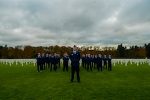 A detail of Airmen assigned to the 52nd Fighter Wing, Spangdahlem Air Base, Germany, stand at parade rest before a Memorial Day ceremony at the Luxembourg American Military Cemetery and Memorial in Luxembourg, Nov. 11, 2016. The ceremony paid tribute to the legacy of service of members of the American armed forces. (U.S. Air Force photo by Staff Sgt. Joe W. McFadden)