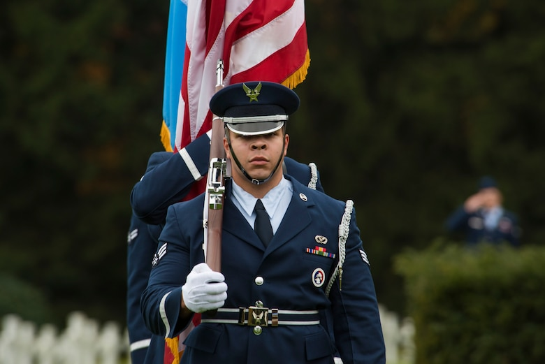 Ceremonial guardsmen from the 52nd Fighter Wing, Spangdahlem Air Base, Germany, march while carrying the Luxembourg and American flags during a Memorial Day ceremony at the Luxembourg American Military Cemetery and Memorial in Luxembourg, Nov. 11, 2016. The ceremony paid tribute to the legacy of service of members of the American armed forces. (U.S. Air Force photo by Staff Sgt. Joe W. McFadden)
